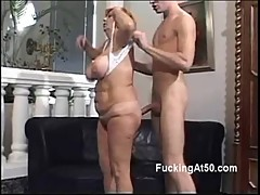 Horny redhead granny gives a young stud a naughty blowjob []